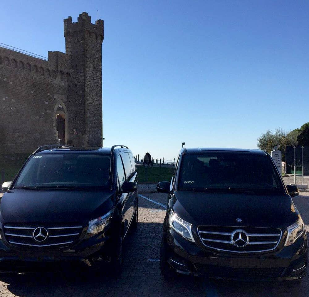 Luxury cars by the Fortress of Montalcino